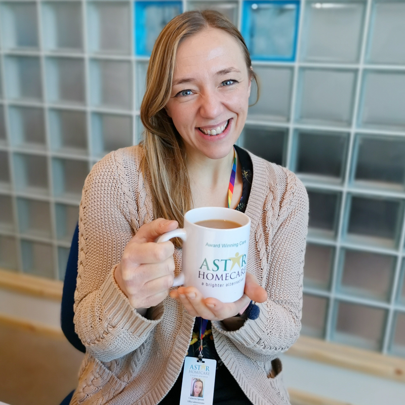 AStar-Homecare-Catherine smiling with a mug of tea