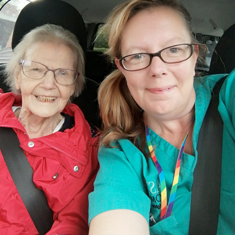 home-care-Astar staff and older lady-in-car
